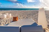 Lounger on beach with tropical sea as background