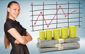 Businesswoman and dollar packs with yellow barrels