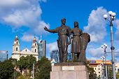 VILNIUS, LITHUANIA - SEPTEMBER 24: Worker and farm woman statues on the Green Bridge on September 24, 2014 in Vilnius, Lithuania. The only bridge in Lithuania featuring sculptures was built in 1952.