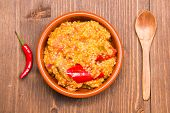 pic of tabouleh  - Couscous with vegetables on a bowl on wooden table seen from above - JPG