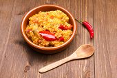 Couscous with vegetables on wood