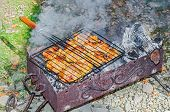 image of brazier  - Grilled chicken leg breast back and steak on the grill - JPG
