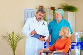 stock photo of pro-life  - doctor and surgeon consulting patient about medication