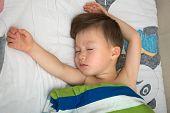 Boy Sleeping  With Widespread Hands