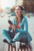 Hipster Beautiful Girl Listening Music