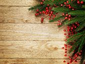 stock photo of fir  - Christmas fir tree on wooden board background with copy space  - JPG