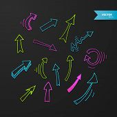 Colorful arrows set on dark background