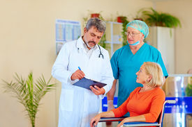 stock photo of pro-life  - doctor and surgeon consulting patient about medication  - JPG