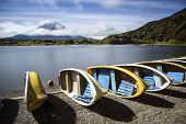 stock photo of mount fuji  - A row of boats sit in front of Mt Fuji in Japan - JPG