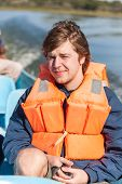 image of raft  - Portrait of a man with  life jacket - JPG
