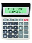 foto of transfer  - Calculator with KNOWLEDGE TRANSFER on display isolated on white background - JPG