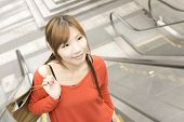 foto of escalator  - Smile shopping woman walk at escalate in Xinyi district - JPG