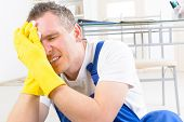stock photo of workplace accident  - Man worker with head injury - JPG