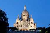 stock photo of moulin rouge  - Sacre Coeur Basilica in night Paris France - JPG