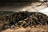 stock photo of crap  - Old car tires in the area of the former Soviet military base in Milovice - JPG