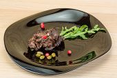 picture of deer meat  - Roasted venison meat with ruccola and cranberries - JPG