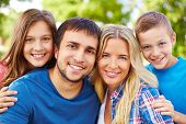 pic of adolescent  - Happy parents and two adolescent children looking at camera - JPG