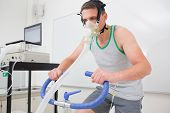 pic of breathing exercise  - Man doing fitness test on exercise bike at the medical centre - JPG