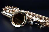 image of saxophones  - Golden saxophone on dark background - JPG