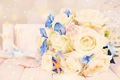 pic of wedding table decor  - Beautiful wedding bouquet with sea decor on wooden table - JPG