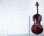foto of cello  - Cello on bricks wall background - JPG