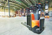foto of pallet  - Manual forklift pallet stacker truck equipment at warehouse - JPG