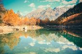 stock photo of mountain-high  - Scenery of high mountain with lake and high peak on a clear day - JPG