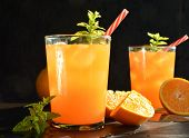 stock photo of vodka  - refreshing drink orange and mint with a little vodka - JPG
