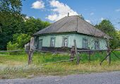 stock photo of forlorn  - Abandoned house in rural area in central Ukraine - JPG