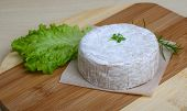 pic of brie cheese  - Camembert brie cheese with herbs on the wood background - JPG