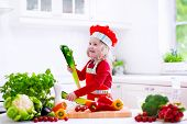 pic of vegetarian meal  - Kids cooking fresh vegetable salad in white kitchen - JPG