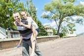 image of time flies  - A Father and daughter having fun time outside - JPG