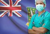 stock photo of virginity  - Surgeon with flag on background  - JPG