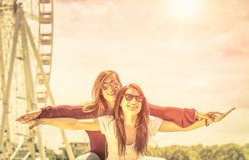 pic of  friends forever  - Best friends enjoying time together outdoors at ferris wheel  - JPG