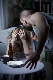 foto of cry  - Drunk aggressive man screaming on crying wife - JPG