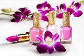Nail polish, lipstick and flowers