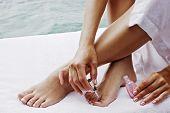 Closeup of female feet and hands. Beauty treatment