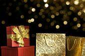Presents on sparkling holiday background