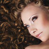 image of beautiful women  - Woman with beautiful makeup and long curly hair - JPG