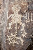 Spiral, Human Figure, Circle And Shield Petroglyph