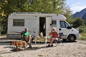 Elderly couple is traveling by motor home