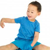 picture of physically handicapped  - Portrait of a Chinese boy with light handicap isolated over white - JPG