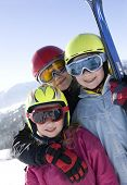 stock photo of family ski vacation  - Young smiling girls with ski - JPG