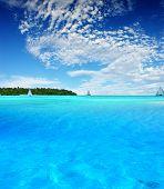 Boats sailing near tropical Island
