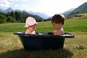 two baby washing