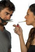 image of stop hate  - Guy trying to help his girlfriend stop smoking - JPG