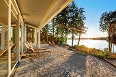 Large Stone Floor Patio Area Of Waterfront House poster