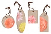 A collection of different shaped tags with pink flowers, isolated on white