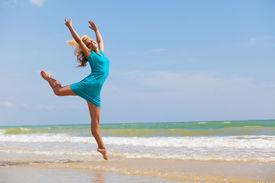 picture of ballet dancer  - beautiful dancer posing on the sandy sea beach - JPG