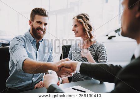 Car Salesman Giving Key Of